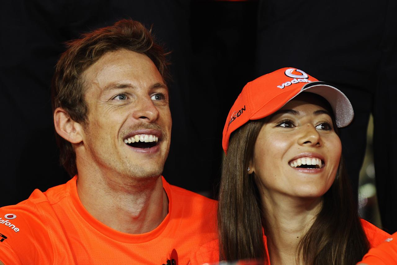 ABU DHABI, UNITED ARAB EMIRATES - NOVEMBER 13:  Third placed Jenson Button of Great Britain and McLaren is seen with his girlfriend Jessica Michibata following the Abu Dhabi Formula One Grand Prix at the Yas Marina Circuit on November 13, 2011 in Abu Dhabi, United Arab Emirates.  (Photo by Mark Thompson/Getty Images)