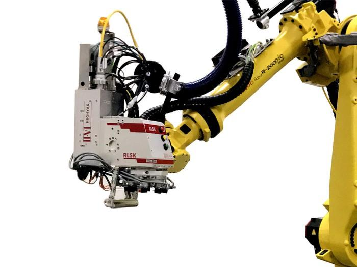 A robotic arm with a laser at the end, with the II-VI logo on it