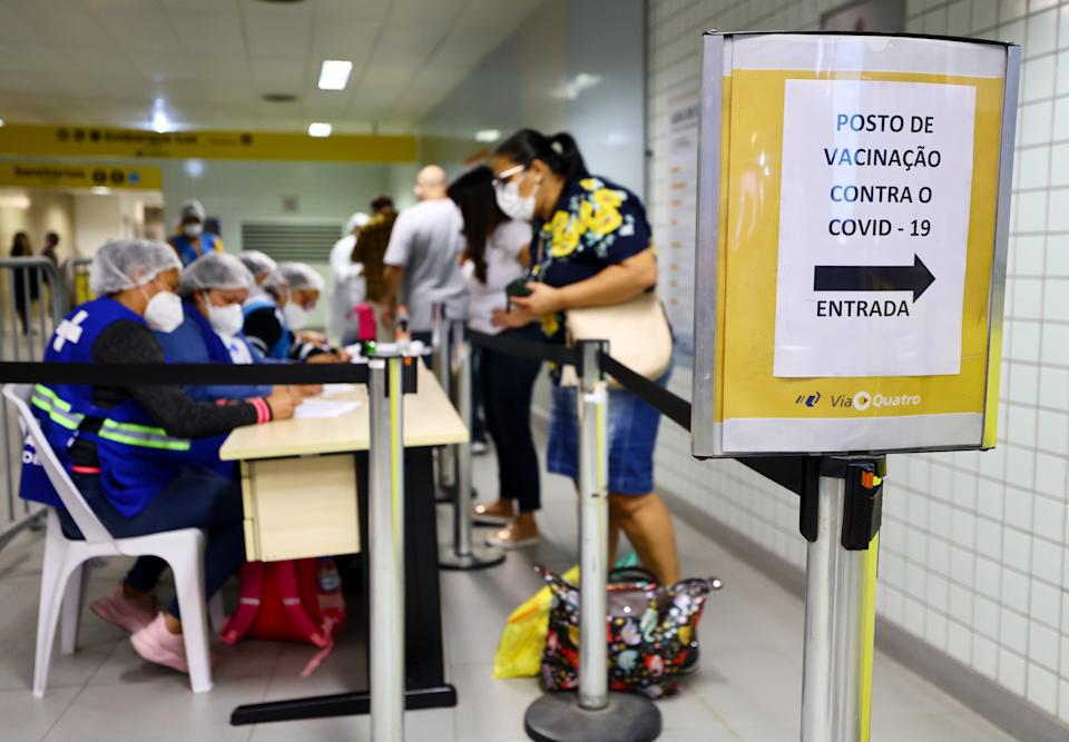 SAO PAULO, BRAZIL - MAY 20: A person checks in to be vaccinated at a COVID-19 vaccination post inside the Republica subway station on May 20, 2021 in Sao Paulo, Brazil. Vaccinations for eligible people are available in a number of public transportation stations in the city. Health experts are warning that Brazil should brace for a new surge of COVID-19 amid a slow vaccine rollout and relaxed restrictions. The state of Sao Paulo has registered more than 3 million cases of COVID-19 and more than 100,000 deaths. More than 440,000 people have died in Brazil by COVID-19, second only to the U.S. (Photo by Mario Tama/Getty Images)
