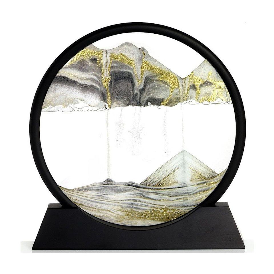 """<p><strong>Rainbow Vision Sand Picture</strong></p><p>amazon.com</p><p><strong>$99.95</strong></p><p><a href=""""https://www.amazon.com/dp/B0038W8YS2?tag=syn-yahoo-20&ascsubtag=%5Bartid%7C2089.g.2100%5Bsrc%7Cyahoo-us"""" rel=""""nofollow noopener"""" target=""""_blank"""" data-ylk=""""slk:Shop Now"""" class=""""link rapid-noclick-resp"""">Shop Now</a></p><p>Bring a sense of zen to their desk with this rotating circle home accessory that delicately drifts sand from top to bottom, mimicking the soothing motions and colors of the beach.</p>"""