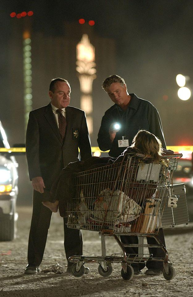 """Grissom and Brass (Paul Guilfoyle) investigate the death of a model found dead with her face mutilated. The leading suspect is her homeless sister living on the streets of Las Vegas. (""""The Hunger Artist"""" 5/18/2002, Season 2 Finale)"""