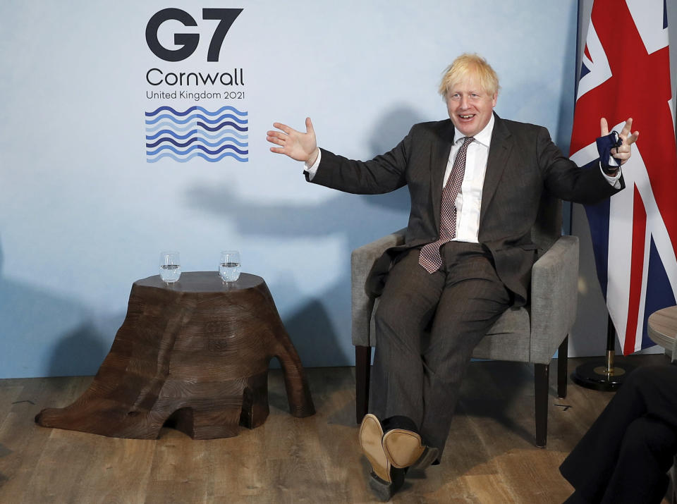 Britain's Prime Minister Boris Johnson meets with European Commission President Ursula von der Leyen and European Council President Charles Michel during the G7 summit in Cornwall, England, Saturday June 12, 2021. (Peter Nicholls/Pool via AP)