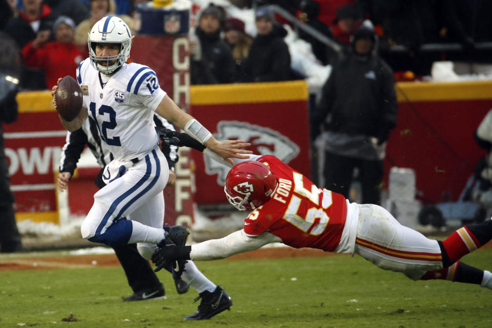 Indianapolis Colts quarterback Andrew Luck runs away from a tackle attempt by Kansas City Chiefs linebacker Dee Ford (55). (AP)