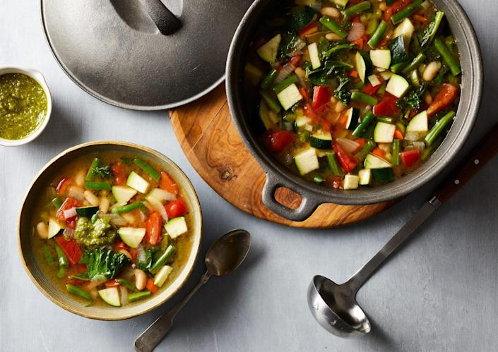 <p>A big bowl of this veggie-packed minestrone will leave you satisfied for hours without consuming a lot of calories--plus it's an easy way to boost your vegetable servings for the day. Top with a dollop of pesto before devouring this delicious skinny vegetable soup.</p>