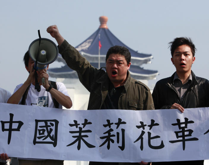 "Chinese democracy activist Wuer Kaixi shouts slogans in support of calls for a ""Jasmine Revolution"" protest in China at the Chiang Kai-shek Memorial Hall in Taipei February 27, 2011. An online call for anti-government protests across China brought an emphatic show of force by police determined to deter any buds of unrest. (Nicky Loh/Reuters)"