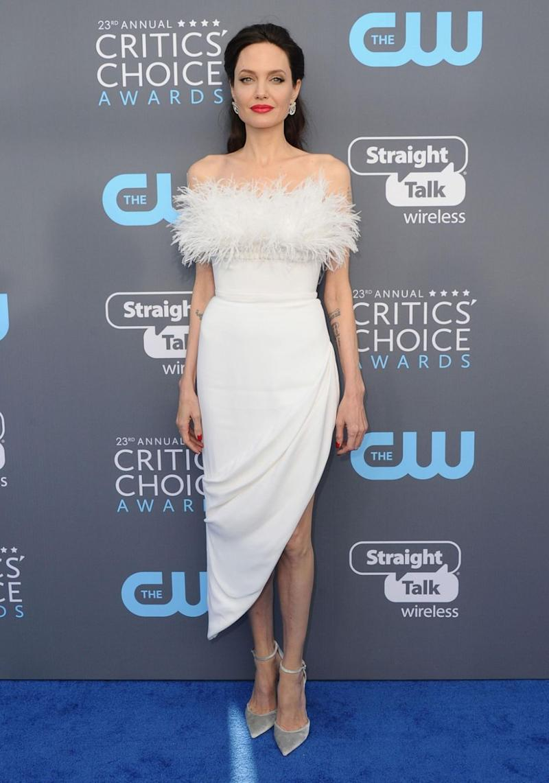 Angelina Jolie was dressed to impress and ruffling a few feathers when she arrived at the 2018 Critics' Choice Awards on Thursday. Source: Getty