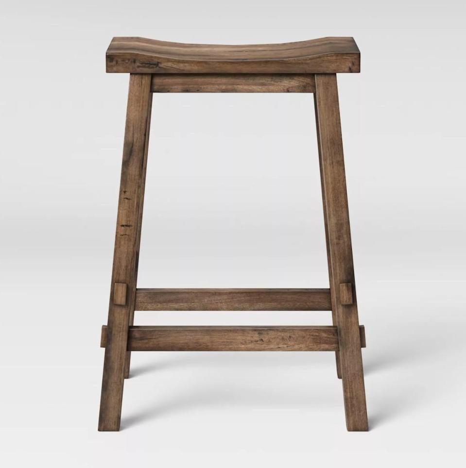 <p>The <span>Threshold Halifax Farmhouse Wood Counter Height Barstool</span> ($60) is easy to tuck away.</p>