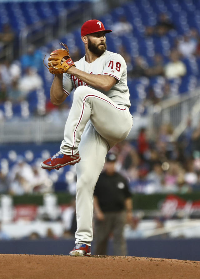 Philadelphia Phillies starting pitcher Jake Arrieta winds up during the first inning of the team's baseball game against the Miami Marlins on Friday, April 12, 2019, in Miami. (AP Photo/Brynn Anderson)