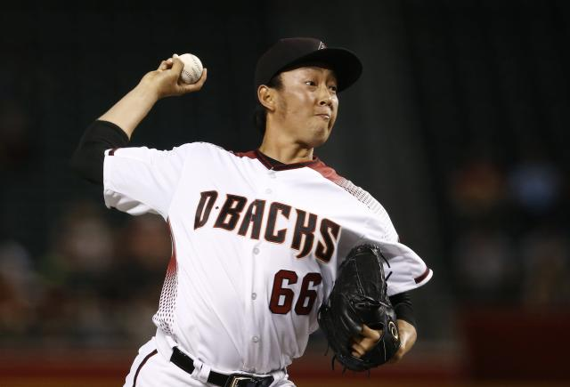 Arizona Diamondbacks relief pitcher Yoshihisa Hirano, of Japan, throws to a San Francisco Giants batter during the eighth inning of a baseball game Wednesday, April 18, 2018, in Phoenix. (AP Photo/Ross D. Franklin)