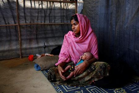 The Wider Image: Young Rohingya mothers flee persecution