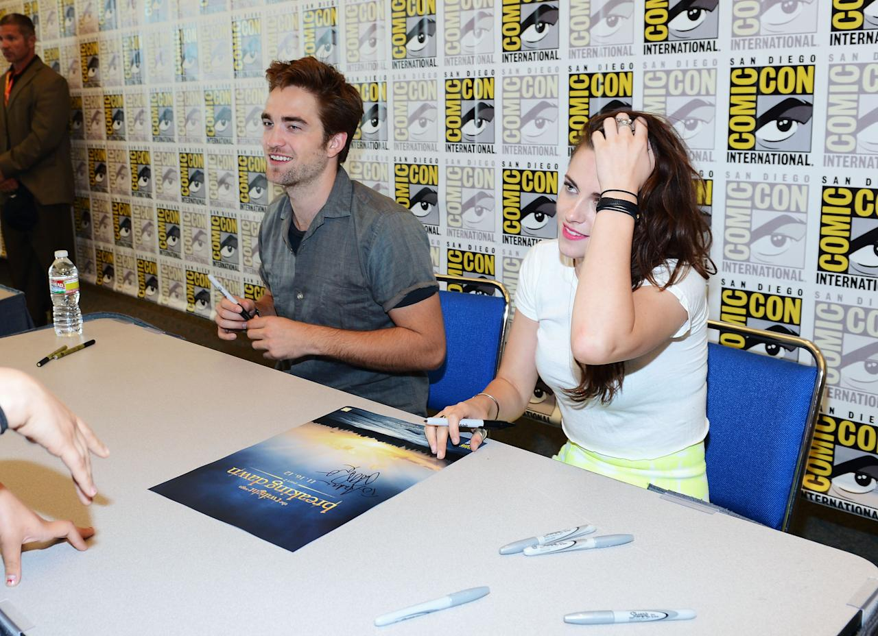 """SAN DIEGO, CA - JULY 12:  Actors Robert Pattinson (L) and Kristen Stewart attend """"The Twilight Saga: Breaking Dawn Part 2"""" during Comic-Con International 2012 at San Diego Convention Center on July 12, 2012 in San Diego, California.  (Photo by Michael Buckner/Getty Images for Lionsgate)"""