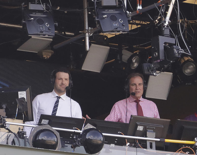 Tony Romo and Jim Nantz, lords of all they survey. (AP Photo/Morry Gash)