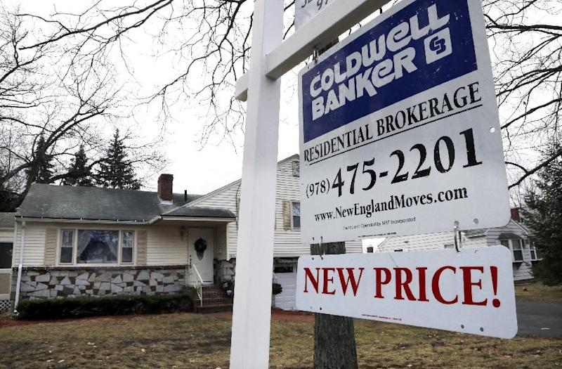 FILE - In this Thursday, Dec. 20, 2012, file photo, a sign hangs in North Andover, Mass.  U.S. sales of previously occupied homes dipped in December from November, in part because of a limited supply of available homes. But for all of 2012, sales rose to their highest level in five years, (AP Photo/Elise Amendola, File)