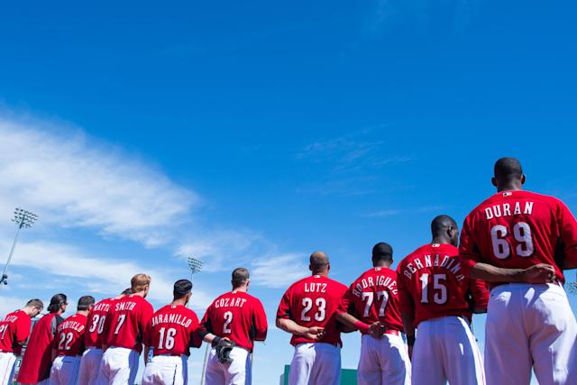 GOODYEAR, AZ - FEBRUARY 27: A general view of members of the Cincinnati Reds standing for he Nationla Anthem before the game against the Cleveland Indians at Goodyear Ballpark on February 27, 2014 in Goodyear, Arizona. (Photo by Rob Tringali/Getty Images)