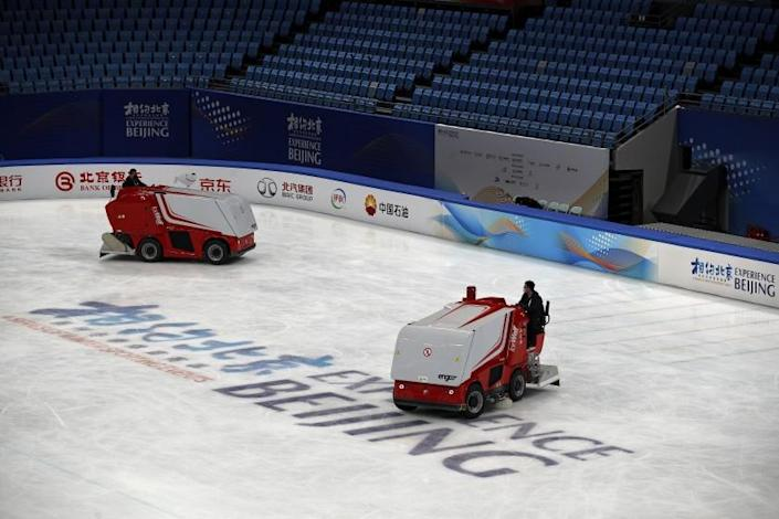 Zambonis resurface the ice skating rink at the Capital Indoor Stadium after a test event for the 2022 Beijing Winter Olympics in Beijing, Friday, April 2, 2021. The organizers of the 2022 Beijing Winter Olympics has started 10 days of testing for several sport events in five different indoor venues from April 1-10, becomes the first city to hold both the Winter and Summer Olympics. (AP Photo/Andy Wong)