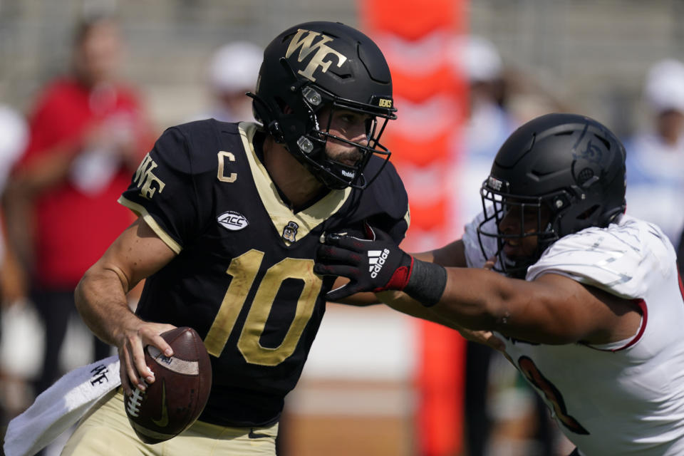 Wake Forest quarterback Sam Hartman looks to pass against Louisville during the second half of an NCAA college football game on Saturday, Oct. 2, 2021, in Winston-Salem, N.C. (AP Photo/Chris Carlson)