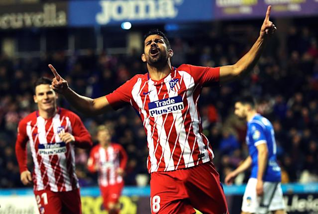 "<a class=""link rapid-noclick-resp"" href=""/soccer/players/diego-costa/"" data-ylk=""slk:Diego Costa"">Diego Costa</a> (18) celebrates after scoring five minutes into his Atletico Madrid return. (EFE)"