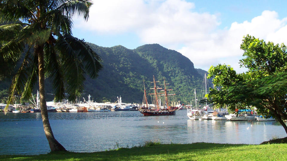 FILE - This July 2002 file photo shows a sailing ship in the harbor at Pago Pago, American Samoa. A federal appeals court ruling says U.S. citizenship shouldn't be imposed on those born in American Samoa. The decision reverses a lower court ruling that sided with three people from American Samoa who lived in Utah. They sued to be recognized as citizens. (AP Photo/David Briscoe, File)