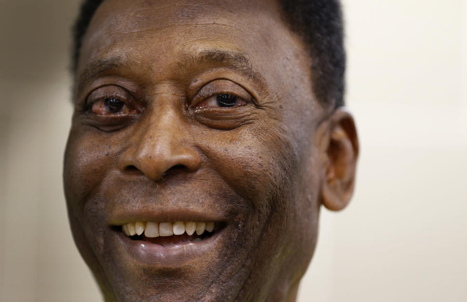 FILE - In this March 20, 2015 file photo, Brazilian soccer legend Pele smiles during a media opportunity at a restaurant in London. Rio's state legislature voted the second week of March 2021, to give Gov. Claudio Castro the authority to rename the historic Maracana stadium after Pele. (AP Photo/Kirsty Wigglesworth, File)