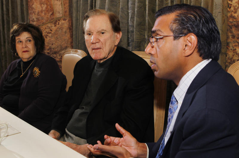 FILE - In this Nov. 14, 2011 file photo, Hall of Fame football player Forrest Gregg, center, and his wife Barbara listen as his Neurologist Dr. Rajeev Kumar talks about Gregg's battle with Parkinson's disease during an interview in Colorado Springs, Colo. Gregg is raising awareness for Parkinson's disease 18 months after his diagnosis. While Gregg and his neurologist believe the debilitating neurological disorder stems from the many concussions he sustained during his playing career, Gregg says he's rebuffed overtures to join thousands of former players suing the NFL. (AP Photo/Ed Andrieski, File)
