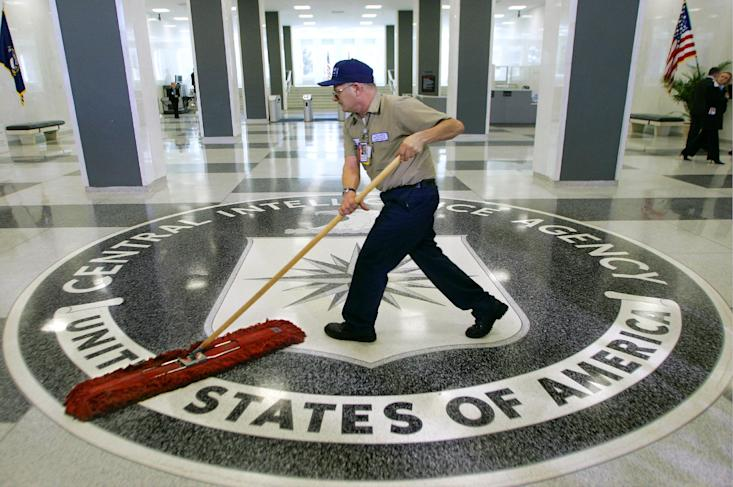 A workman slides a dust mop over the floor at the Central Intelligence Agency headquarters in Langley, Va. (AP Photo/J. Scott Applewhite)