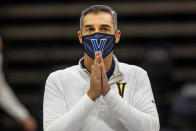 Villanova coach Jay Wright gestures before the team's NCAA college basketball game against Creighton, Wednesday, March 3, 2021, in Villanova, Pa. (AP Photo/Laurence Kesterson)