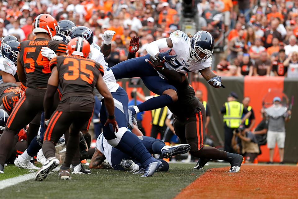 Derrick Henry #22 of the Tennessee Titans dives into the endzone for a touchdown during the second quarter of the game against the Cleveland Browns at FirstEnergy Stadium on September 8, 2019 in Cleveland, Ohio. (Photo by Kirk Irwin/Getty Images)