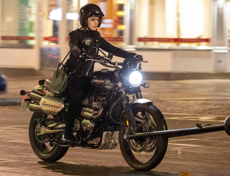 <p>Anne Hathaway rides a motorcycle through London for the pandemic-themed film <i>Lockdown</i> on Tuesday. </p>