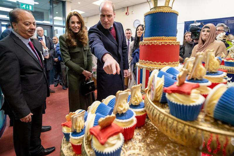 Prince William, Duke of Cambridge and Catherine, Duchess of Cambridge inspect cakes as they visit the Khidmat Centre on January 15, 2020 in Bradford, United Kingdom. (Photo by Charlotte Graham - WPA Pool/Getty Images)