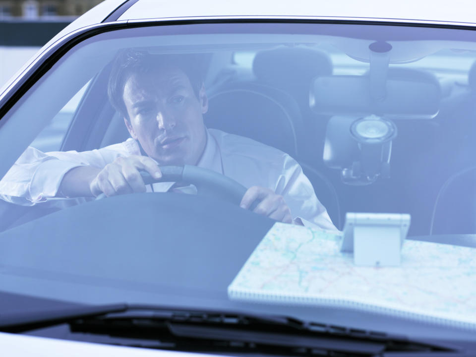 A man looking confused while driving.