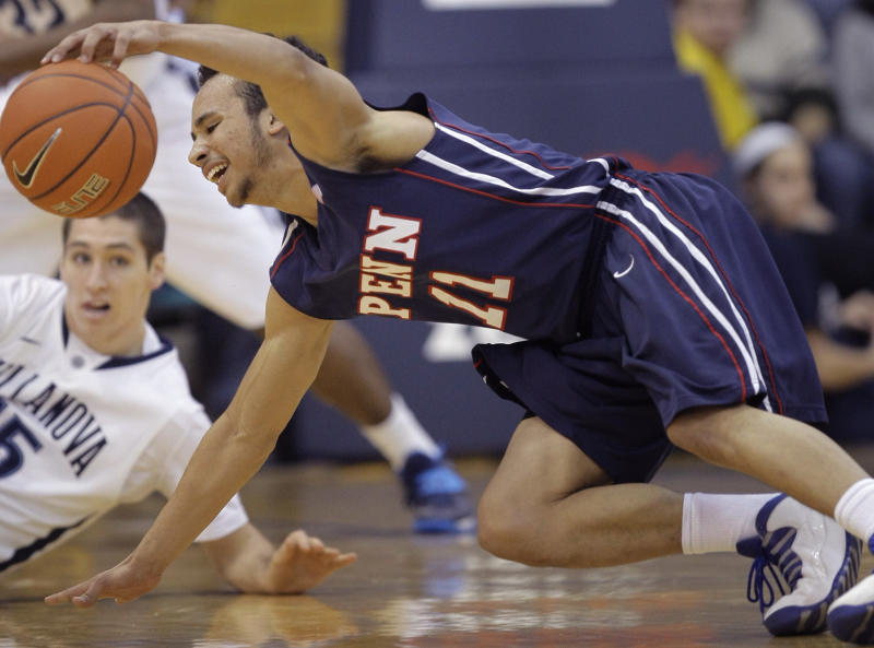 Penn's Tony Bagtas (11) tumbles with Villanova's Ryan Arcidiacono, left, while trying to regain control of the ball in the first half of an NCAA college basketball game, Wednesday, Dec. 4, 2013, in Villanova, Pa. (AP Photo/Laurence Kesterson)