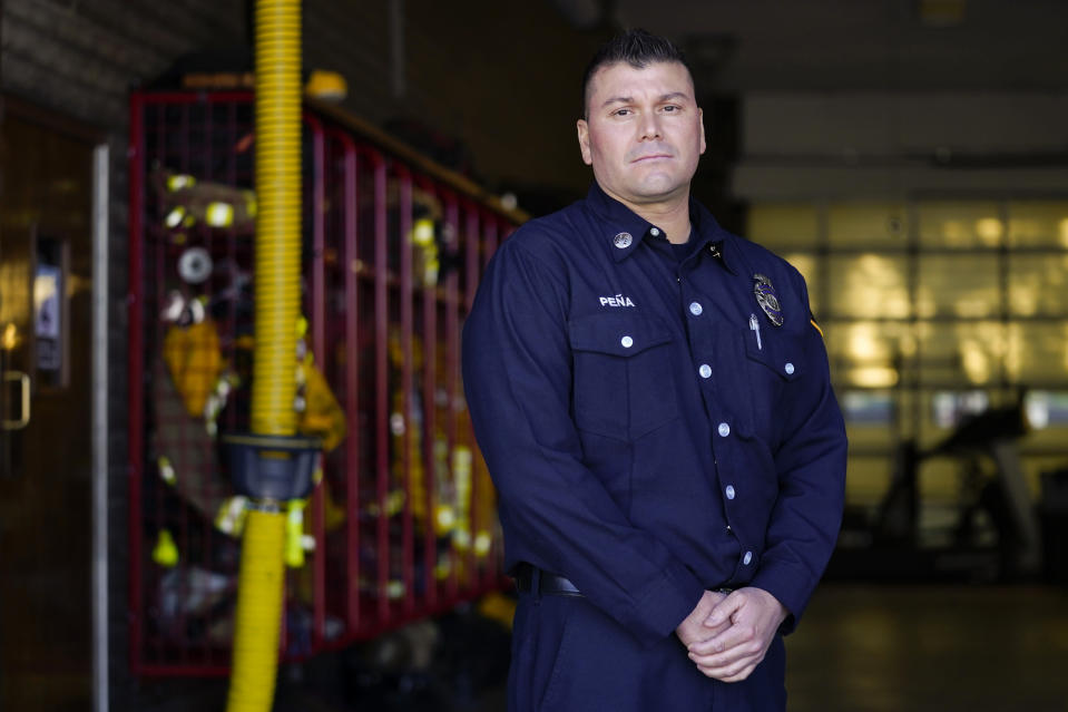 Fire Engine Captain Joe Peña of Los Angeles County Fire Department - Station 106 poses for a photo at his station Friday, Feb. 26, 2021, in Rancho Palos Verdes, Calif, a suburb of Los Angeles. He was among first responders at the scene of a vehicle crash involving Tiger Woods on Tuesday. (AP Photo/Ashley Landis)