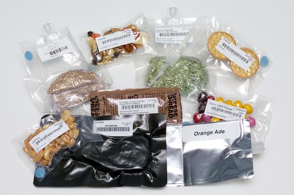 Assorted NASA space food samples, including freeze-dried and thermally-stabilized dishes, drinks and desserts.