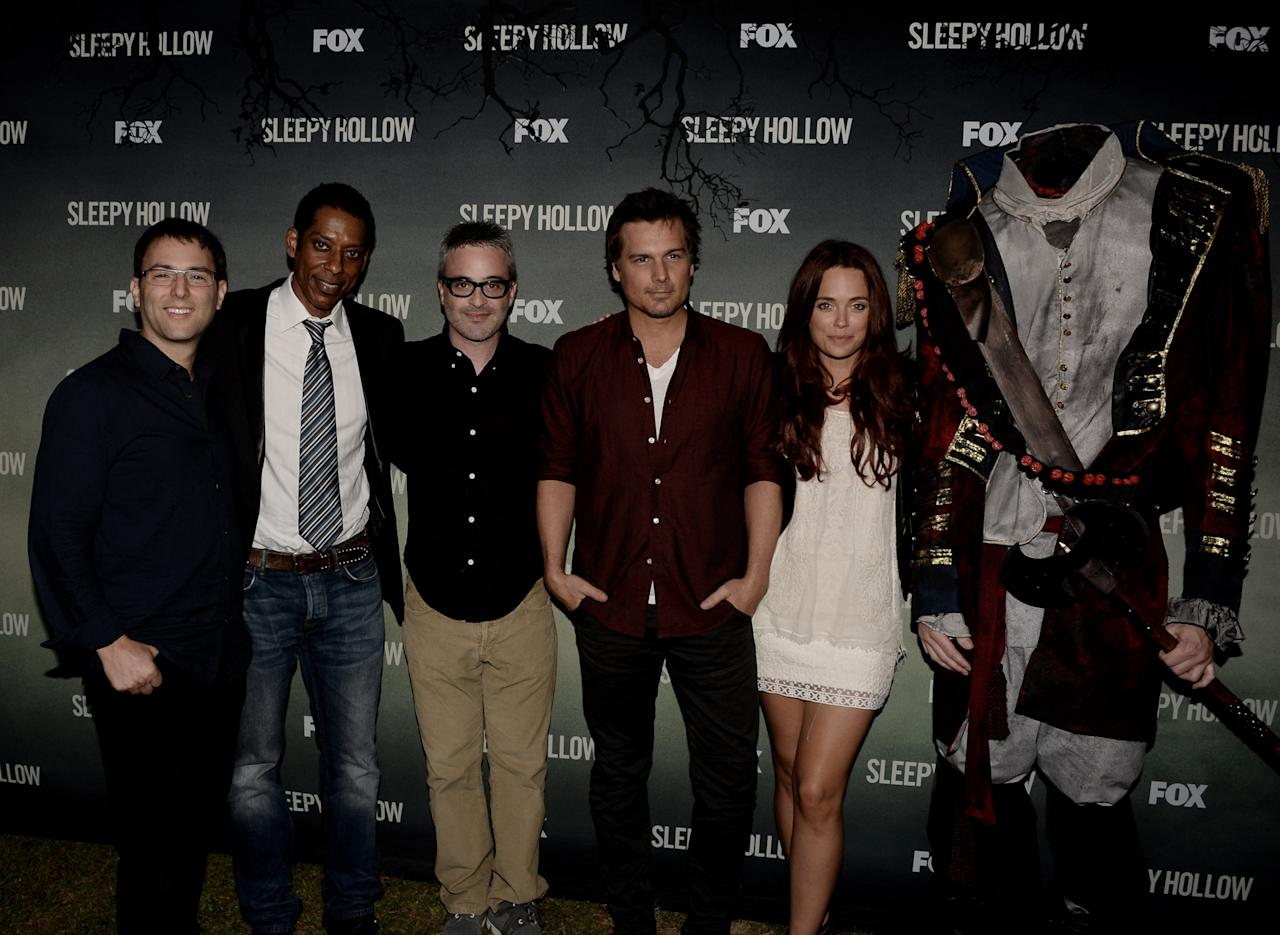 "LOS ANGELES, CA - SEPTEMBER 08: (L-R) Executive producer Mark Goffman, actor Orlando Jones, executive producers Alex Kurtzman, Len Wiseman and actress Katia Winter pose at a special screening of 20th Century Fox Television's ""Sleepy Hollow"" at the Hollywood Forever Cemetery on September 8, 2013 in Los Angeles, California. (Photo by Kevin Winter/Getty Images)"