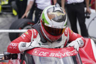 Simona De Silvestro, of Switzerland, climbs out of her car during qualifications for the Indianapolis 500 auto race at Indianapolis Motor Speedway, Sunday, May 23, 2021, in Indianapolis. (AP Photo/Darron Cummings)