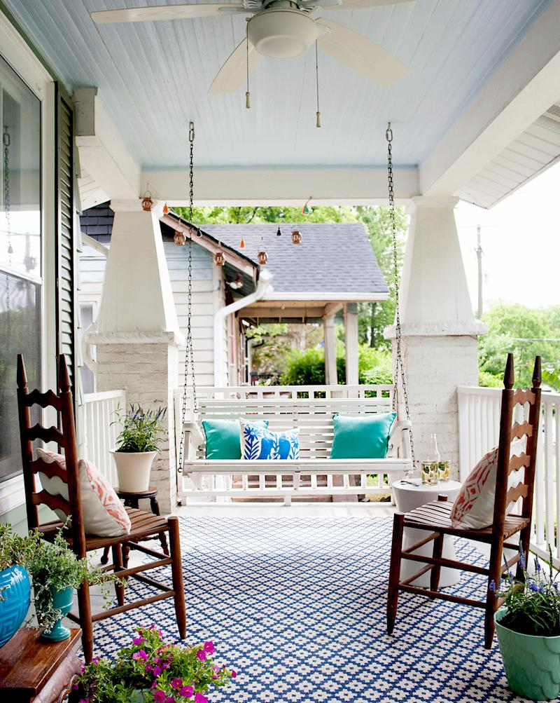 Porch with tiled floor and wooden chairs