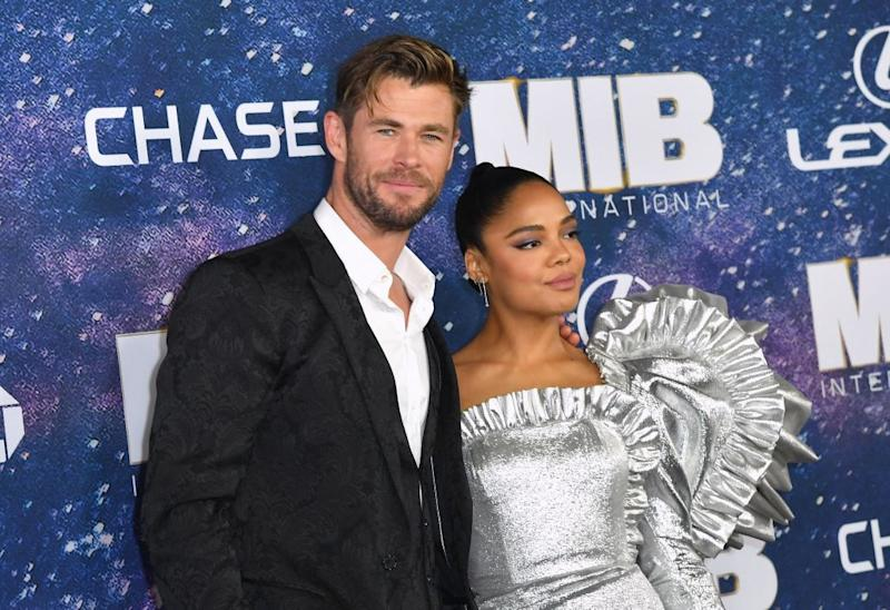 """Australian actor Chris Hemsworth and US actress Tessa Thompson attend the """"Men In Black: International"""" premiere at AMC Lincoln Square on June 11, 2019 in New York City. (Photo by Angela Weiss / AFP)"""