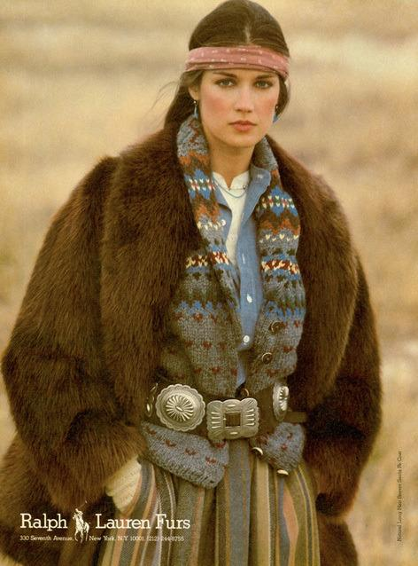 <p>A model wears a prairie skirt and fur coat accessorized with a bandana on her head and a Native American silver belt. This mix of heritage and trend is one of Ralph Lauren's styling trademarks.</p>