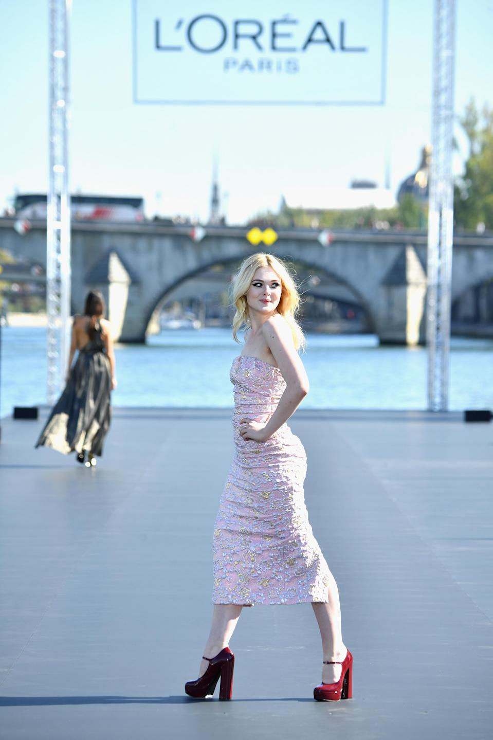 Elle Fanning on the L'Oreal catwalk at Paris Fashion Week. [Credit: L'Oreal]