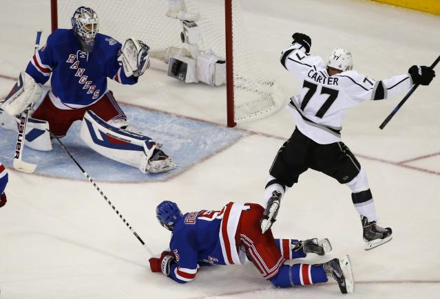 Kings Carter celebrates his goal on Rangers goalie Lundqvist during Game 3 of their NHL Stanley Cup Finals hockey series in New York