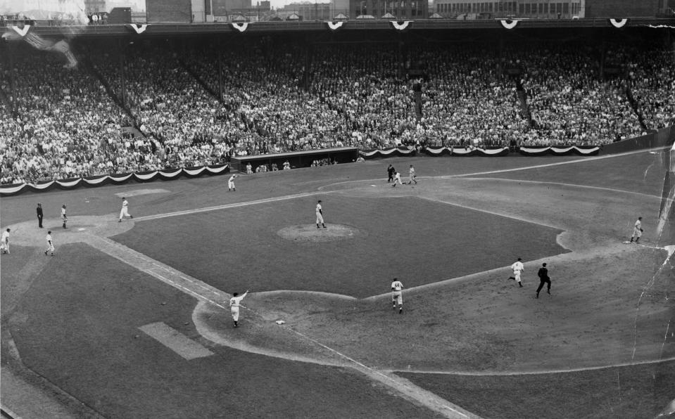 BOSTON, MA - JULY 9: Joe Gordon of the New York Yankees doubles to center field, scoring Ted Williams of the Boston Red Sox and Charlie Keller of the New York Yankees during the 7th inning of the 1946 MLB All-Star Game at Fenway Park in Boston on Jul. 9, 1946.  (Photo by Charles F. McCormick/The Boston Globe via Getty Images)