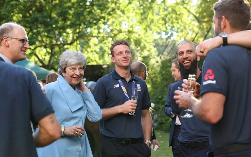 Prime Minister Theresa May with Jos Buttler and members of the England cricket team - PA POOL
