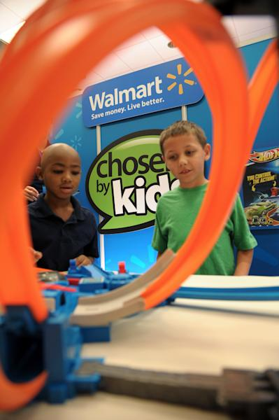 In this undated photo provided by Wal-Mart, two of about 1,000 boys and girls aged 18 months to 10 years play with a toy as part of an event during August 2013 in Dallas. The children chose their favorites, resulting in a top 20 list of kid-approved toys. (AP Photo/Wal-Mart)