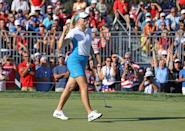 Finland's Matilda Castren celebrates after closing out her singles match win to ensure Europe retains golf's Solheim Cup (AFP/Gregory Shamus)