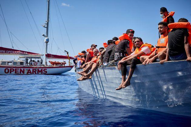 LAMPEDUSA ITALY, SPAIN - SEPTEMBER 08: The boat 'Astral', of the NGO Open Arms, next to a boat where a total of 70 migrants are traveling, on September 8, 2021, in the Mediterranean Sea, in the vicinity of Lampedusa, Sicily (Italy). The boat 'Astral', of the NGO Open Arms, has sighted a boat three miles off the island of Lampedusa. A total of 70 people are on the boat. Among them, there are at least four children between three and 10 years old. The boat had departed 24 hours earlier from the beaches of Tunisia. The boat 'Astral' has alerted the Lampedusa Coast Guard authorities to indicate the position of the boat, the number of people on board and the state they are in. After the arrival of a patrol boat, the people on board were taken to the port of Lampedusa to be identified. While waiting for the patrol boat, each person was given a life jacket and water. (Photo By Jesus Hellin/Europa Press via Getty Images) (Photo: Europa Press News via Getty Images)