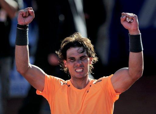 Rafael Nadal celebrates after winning the final of the Barcelona Open tournament Conde de Godo against compatriot David Ferrer, on April 29. Nadal became the first man to win two separate events seven times, as he defeated Ferrer 7-6 (7/1), 7-5, to win a seventh trophy in Barcelona