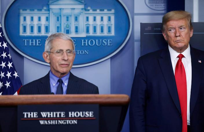 Donald Trump eyes Anthony Fauci during an April coronavirus briefing: REUTERS