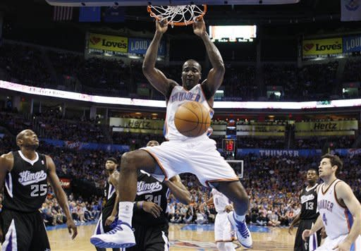 Oklahoma City Thunder center Kendrick Perkins dunks in front of Sacramento Kings forwards Travis Outlaw (25) and Jason Thompson (34) during the first quarter of an NBA basketball game in Oklahoma City, Tuesday, April 24, 2012. (AP Photo/Sue Ogrocki)