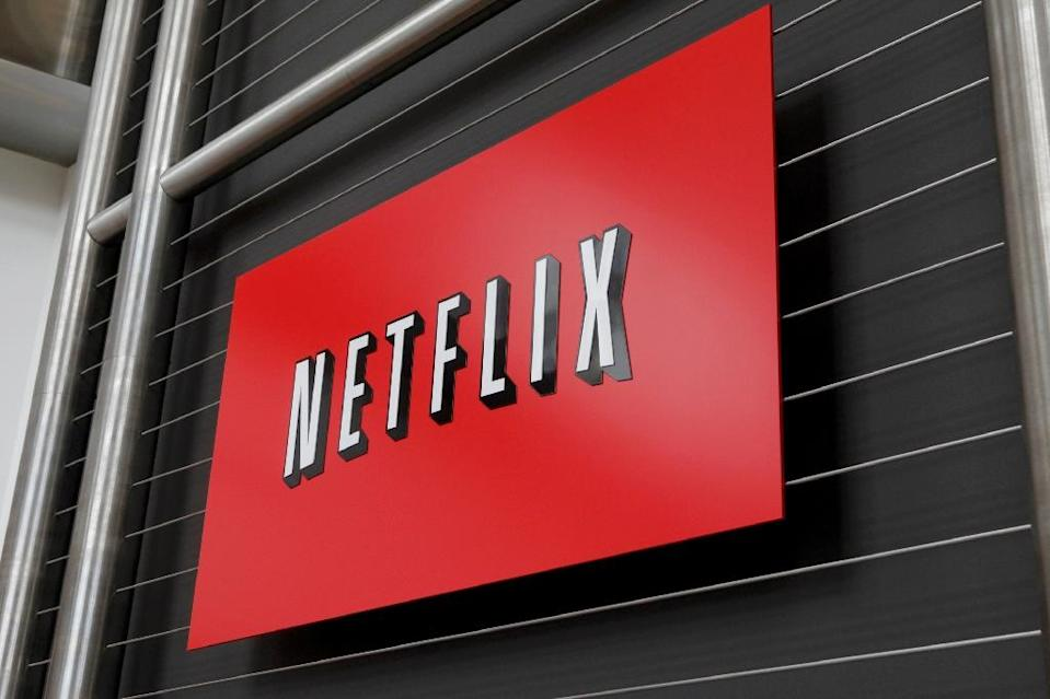 AT&T argues that online platforms like Netflix have an advantage over traditional television rivals by collecting data that can be used to customize ads and content (AFP Photo/Ryan Anson)