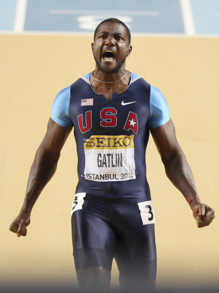 United States' Justin Gatlin celebrates winning the Men's 60m final during the World Indoor Athletics Championships in Istanbul, Turkey, Saturday, March 10, 2012. (AP Photo/Michael Probst)